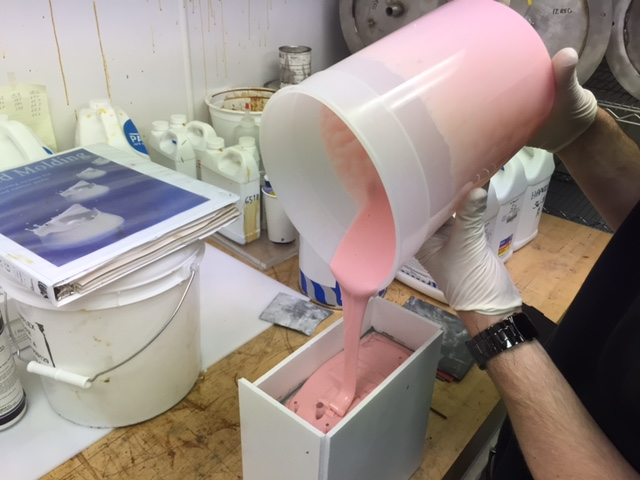 Pouring new top half of mold